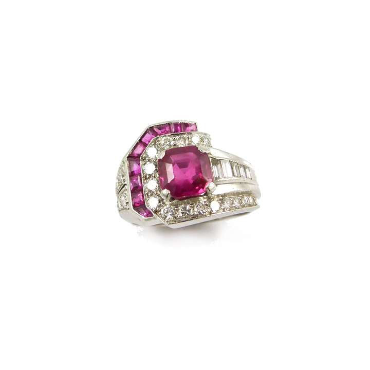 Ruby and diamond geometric cluster ring centred by an octagonal cut Burma ruby