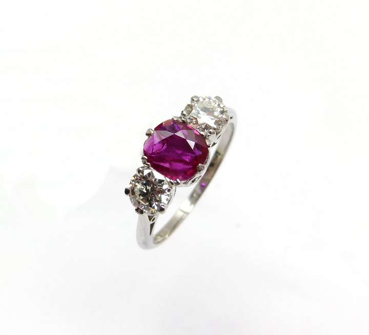 Ruby and diamond three stone ring centred by a 1.00ct cushion shaped Burma ruby