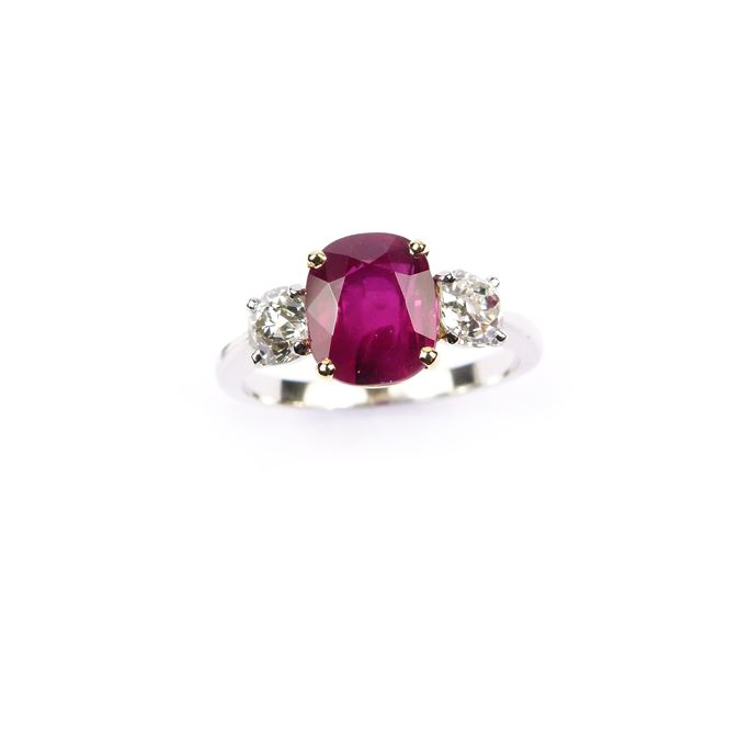 Ruby and diamond three stone ring, claw set with a cushion cut 2.52ct Burma ruby | MasterArt