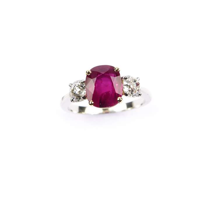 Ruby and diamond three stone ring, claw set with a cushion cut 2.52ct Burma ruby