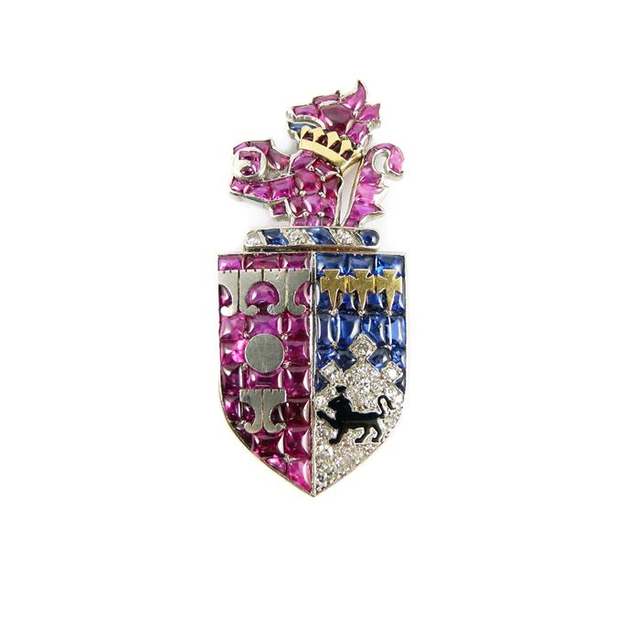 Cartier - Ruby, diamond, sapphire and enamel armorial clip brooch depicting the arms of Smith of Bristol, Somerset | MasterArt