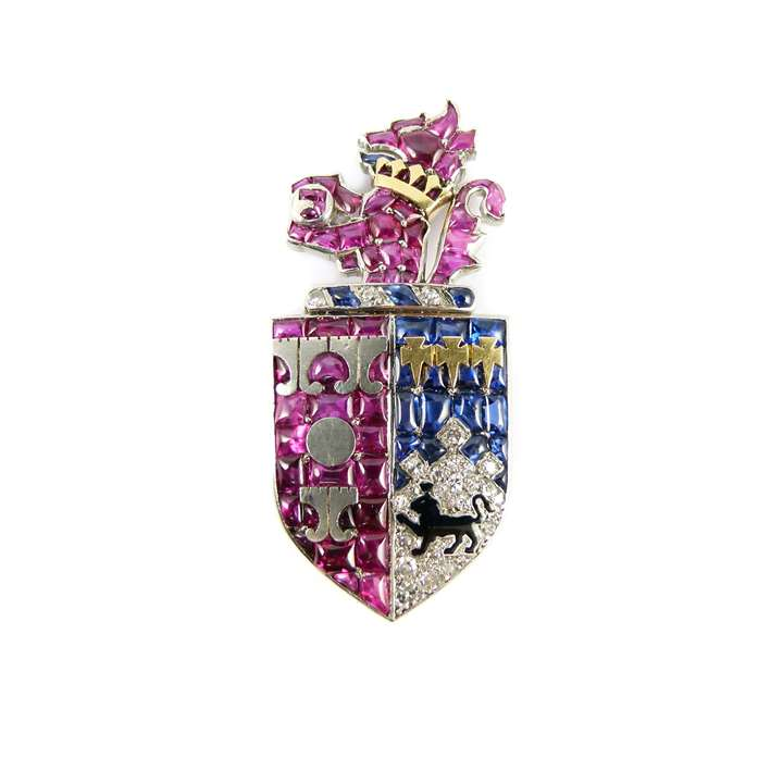 Ruby, diamond, sapphire and enamel armorial clip brooch depicting the arms of Smith of Bristol, Somerset