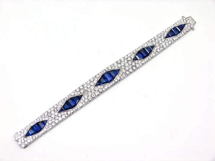 Sapphire and diamond articulated strap bracelet