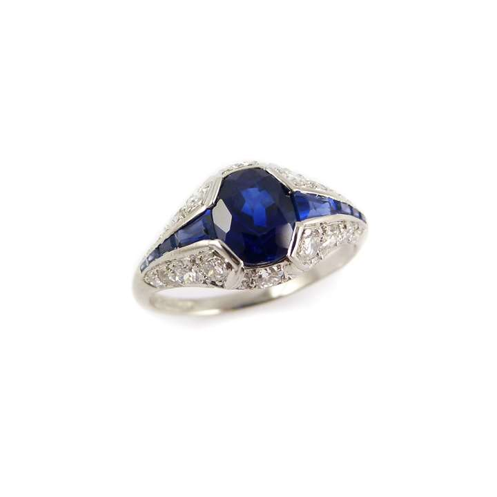 Sapphire and diamond cluster ring, the central cushion shaped sapphire 1.48ct