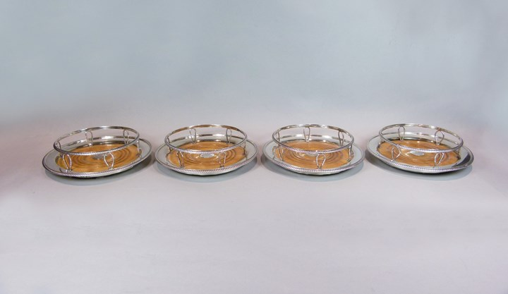 Set of four George III silver wine coasters