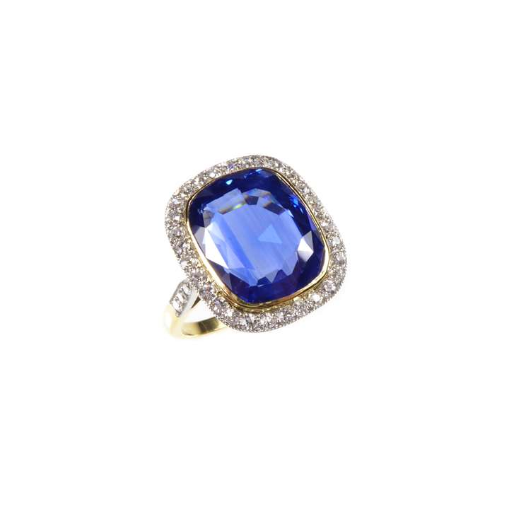 Single stone cushion cut sapphire and diamond cluster ring