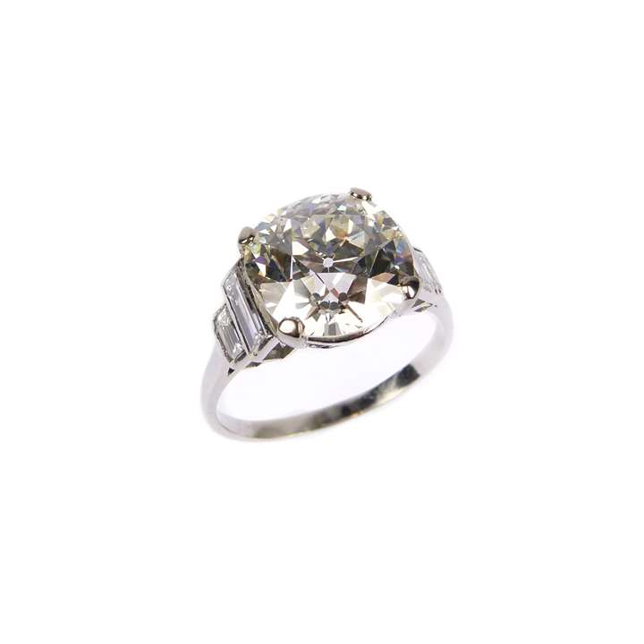 Single stone diamond ring, claw set with a 5.98ct rounded cushion cut diamond