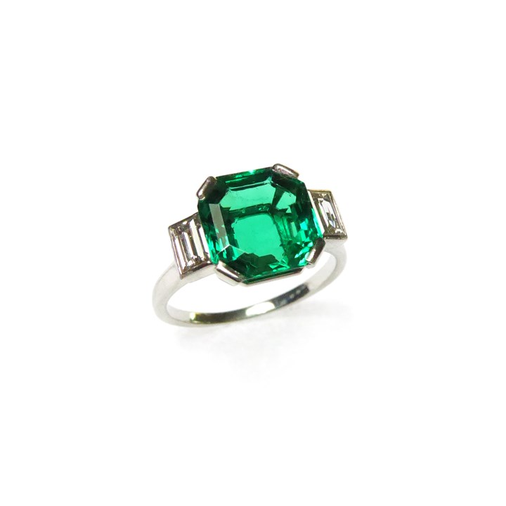 Single stone emerald and diamond ring