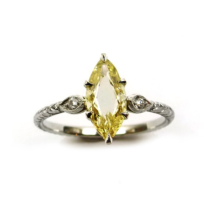 Single stone fancy yellow marquise portrait cut diamond ring, the 0.61ct stone claw set