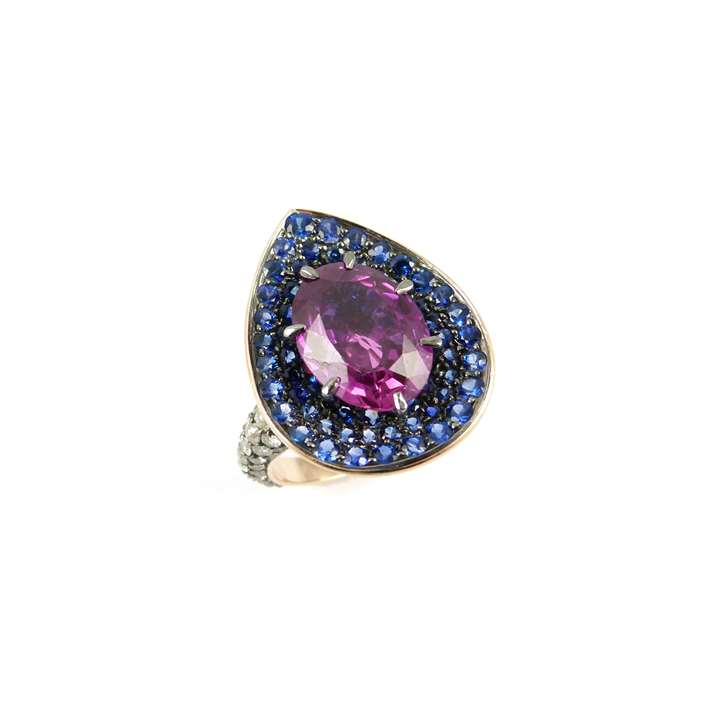 Single stone oval cut pink sapphire, sapphire and diamond cluster ring, centred by a 5.58ct purplish-pink Ceylon sapphire