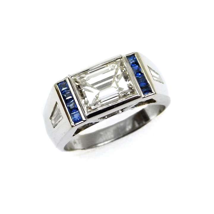 Single stone rectangular cut diamond ring