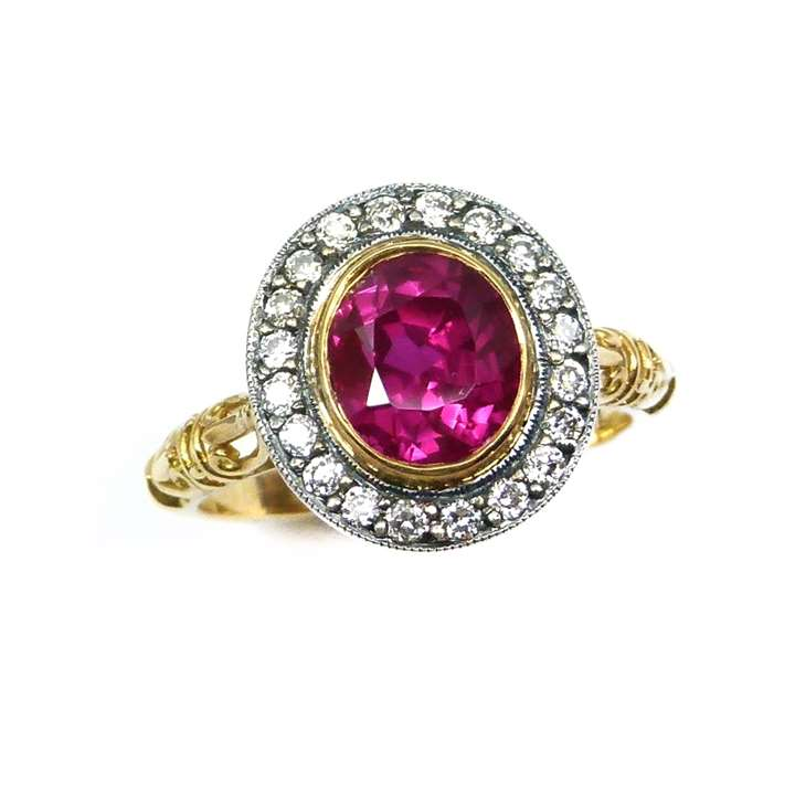 Single stone ruby and diamond cluster ring
