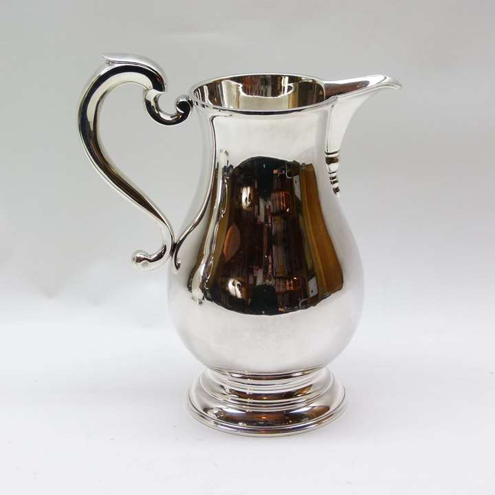 Sterling silver baluster shaped jug by C.J. Vander Ltd
