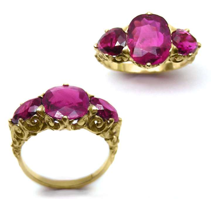 Three stone Burma ruby ring, the central oval cushion-cut ruby