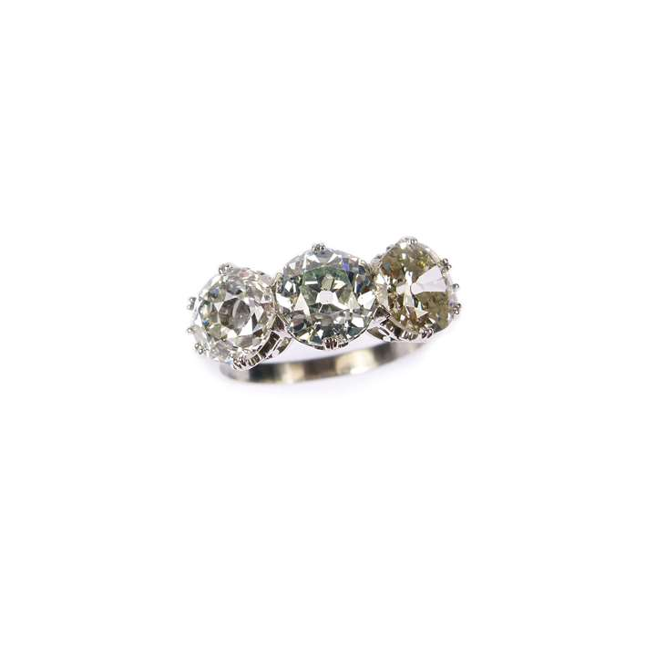 Three stone coloured and white diamond ring