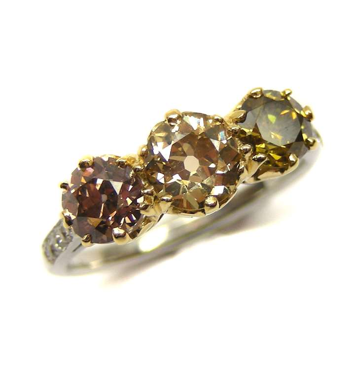 Three stone coloured diamond ring
