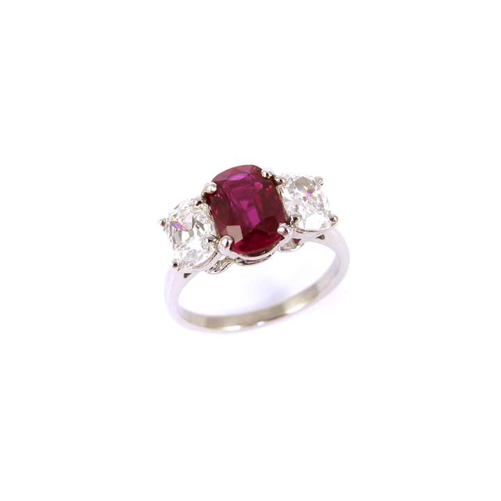 Three stone cushion cut Burma ruby and diamond ring, the 1.85ct ruby between cushion cut diamonds