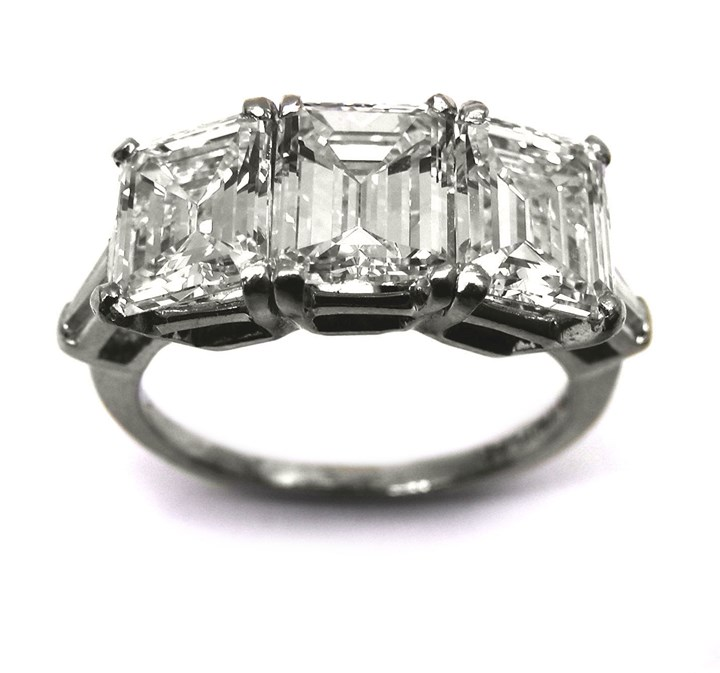 Three stone rectangular cut diamond ring