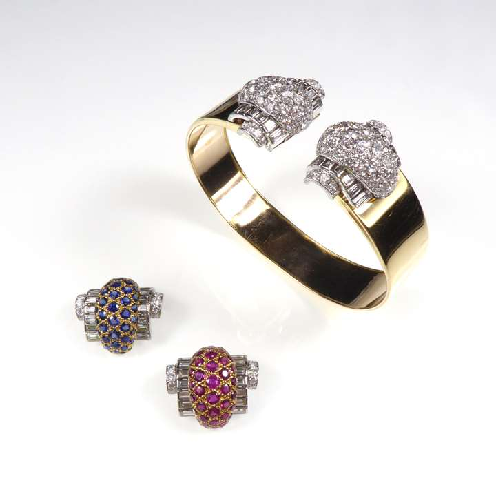 Two matching pairs of diamond, sapphire and ruby interchangeable clip brooches  with bangle and earring fittings