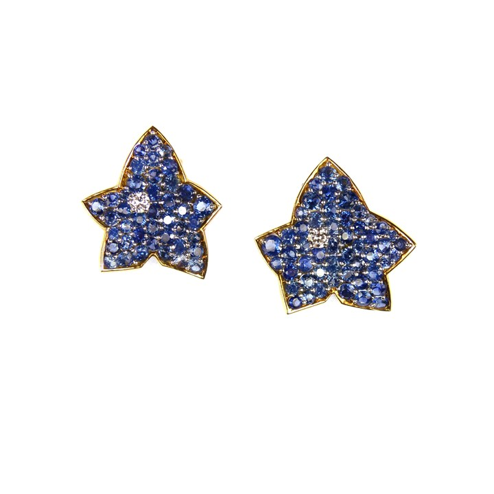 Two matching sapphire and diamond maple leaf brooches, one slightly larger