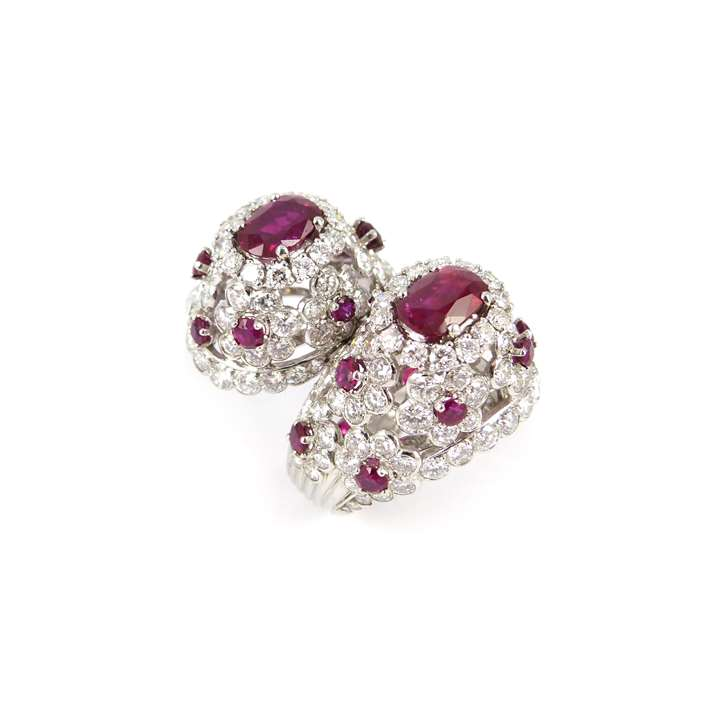Two stone ruby and diamond cluster crossover ring