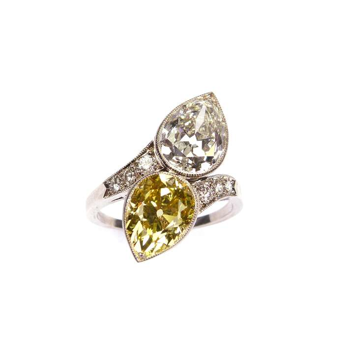 Two stone yellow and white diamond crossover ring, set with a 3.30ct fancy vivid yellow pear diamond opposite a 3.26ct E VS1 pear diamond,