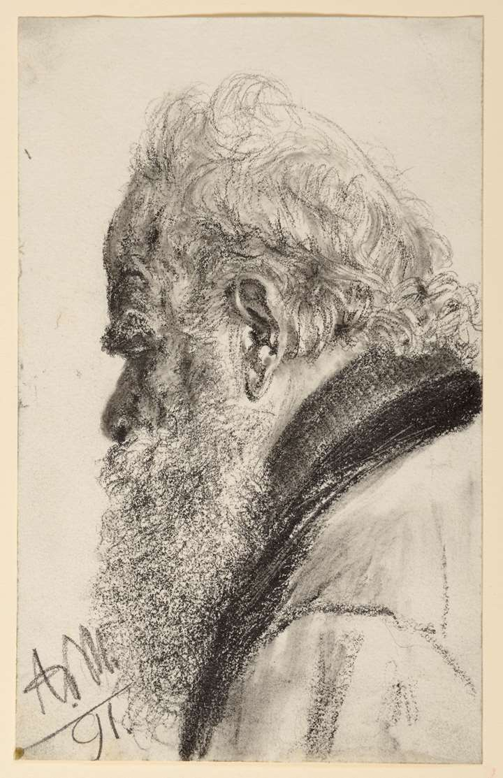 A Bearded Man Looking Down to the Left