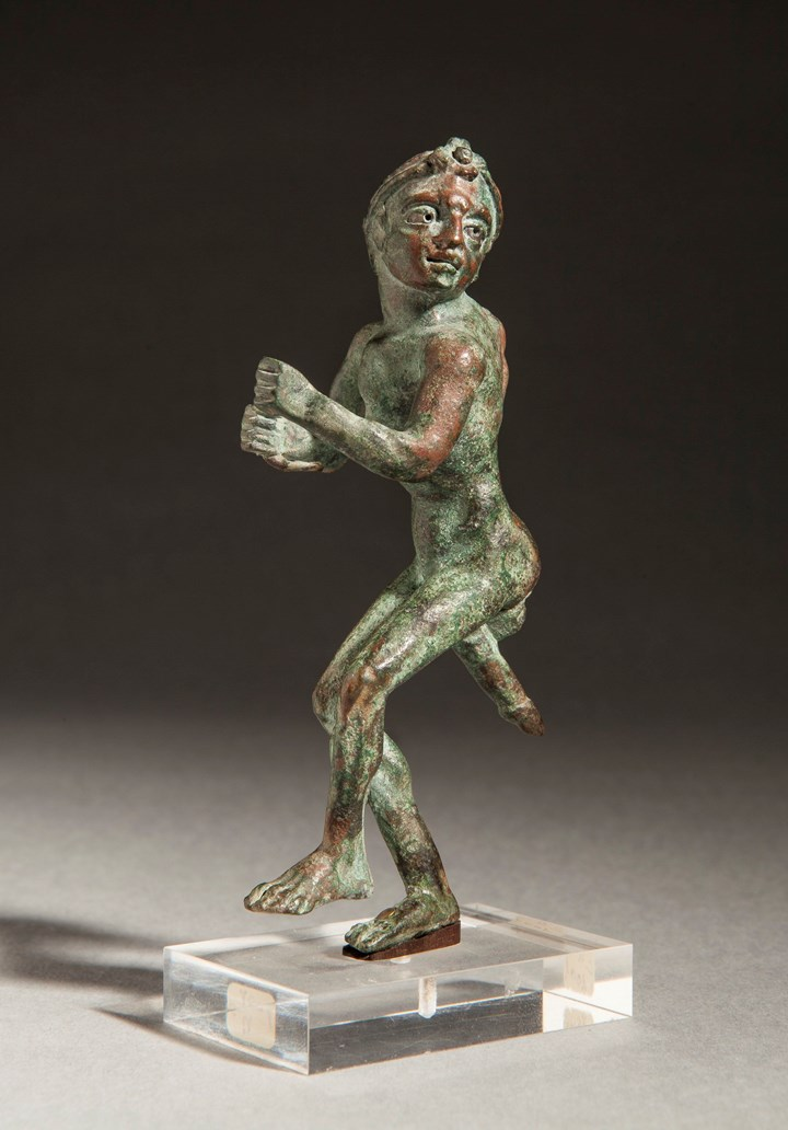 Grotesque dancing figure