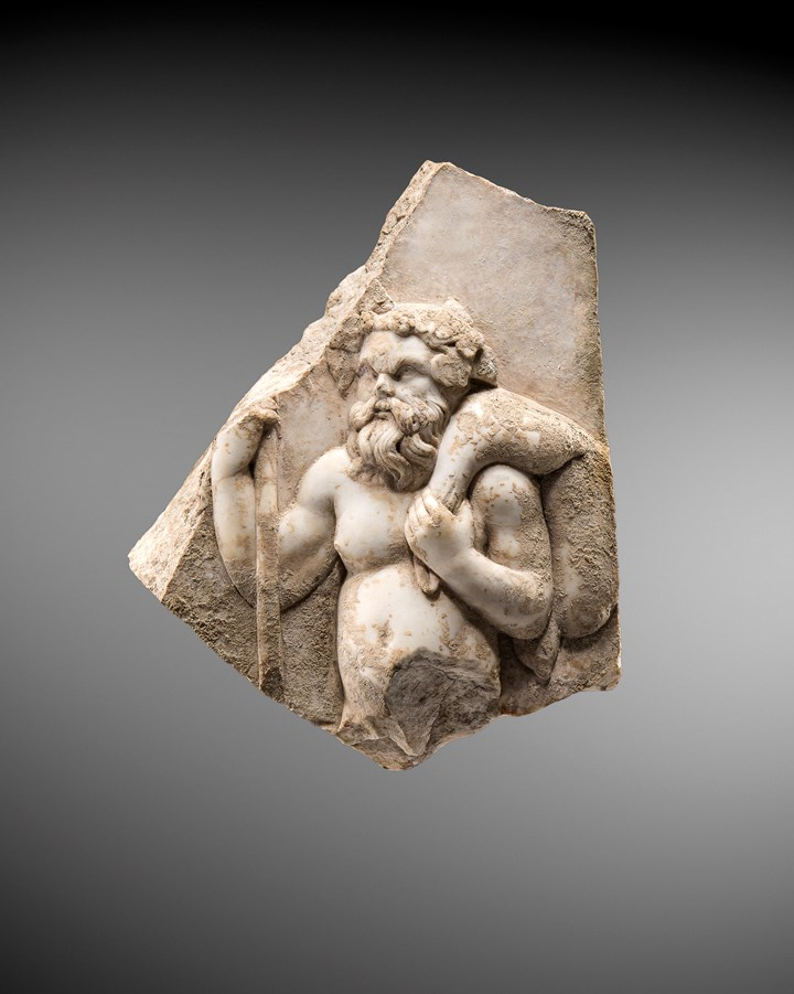 Marble relief fragment representing a Silenos